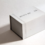 René Moritz, Artist's box 2014, Pappe, Acrylglas, Folie, Architektenpapier, Acrylglaslinse, Kerze, 10 x 7 x 6 cm, Auflage 50