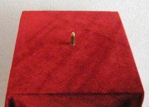 "Franziska Becher, ""Kaliber 50 Cent"", 1 Patrone (abgefeuert) aus dem Metall von etwa drei 50-Cent-Münzen. Gewicht: ca. 8,3 Gramm, // Foto: Kunstv. Neuk. e.V."